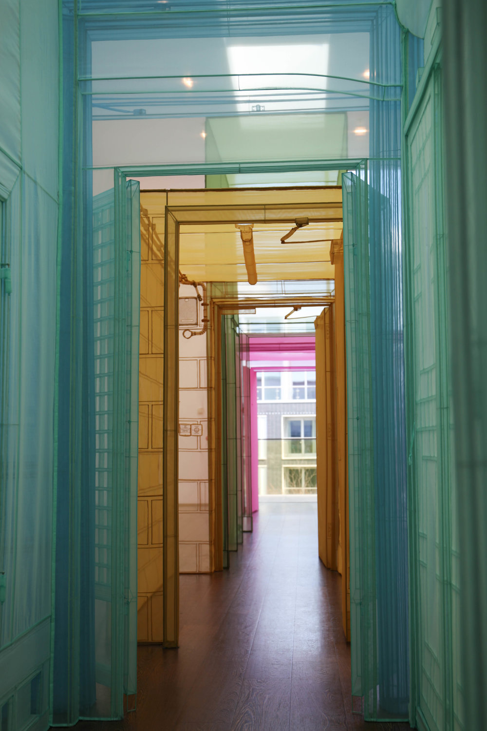 "Passage/s, 2105; a walk-through configuration of meticulously replicated places that Do Ho Suh has lived and worked. Formed in stainless steel at one-to-one scale in richly coloured polyester fabric, these are transitory, connecting spaces are the mundane ""getting from a to b"" places that nobody really sees."