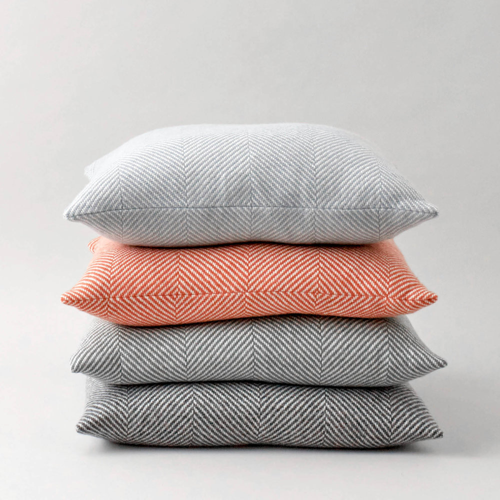 Stacked; Sky Blue, Tangerine Orange, Sage Green & Storm Grey Herringbone cushions, £65