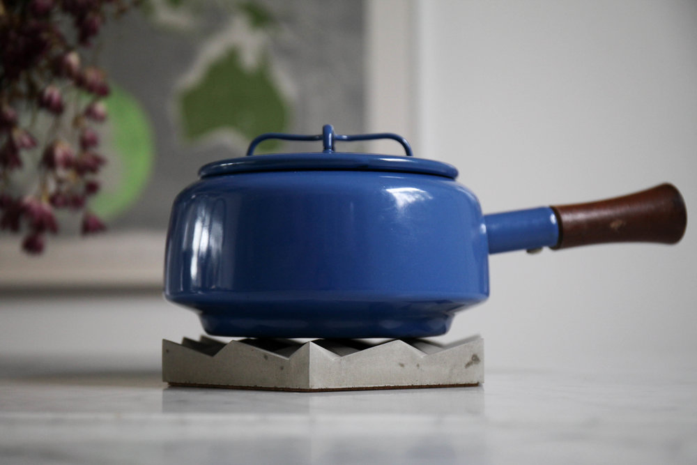 Rest here a while; the concrete trivet has a cork base to protect your table when it's holding your pots & pans