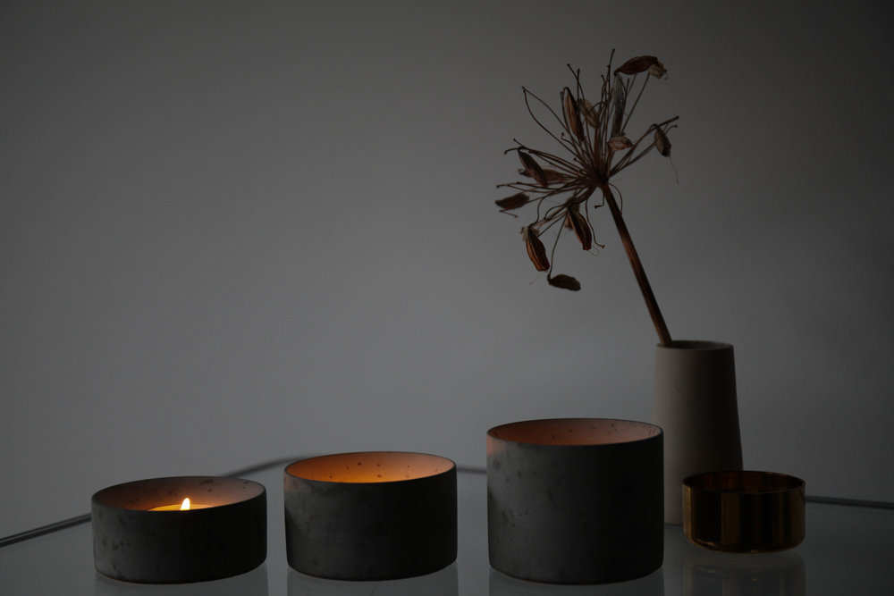 Oxymoron: soft concrete; the warmth of the candle light does exactly that to the concrete