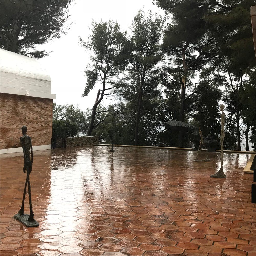 Giacometti's standing on the terrace in the torrential rain