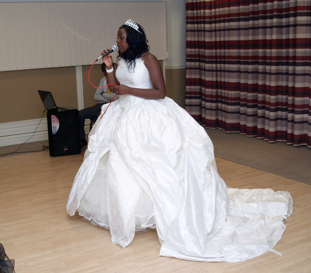 Me giving my speech, I was so nervous. I remember it being so difficult to get up there pushing past all the chairs in my huge dress