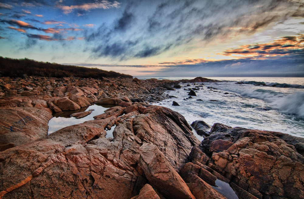Marion is a master Landscape photographer and she used Photoshop to straighten the horizon, enhance the sky, remove some red from the rocks, and added a vignette to darken the edges.