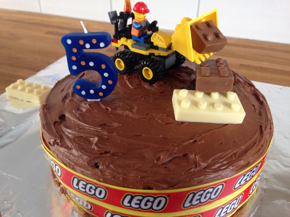 Homemade chocolate fudge cake with edible Lego.