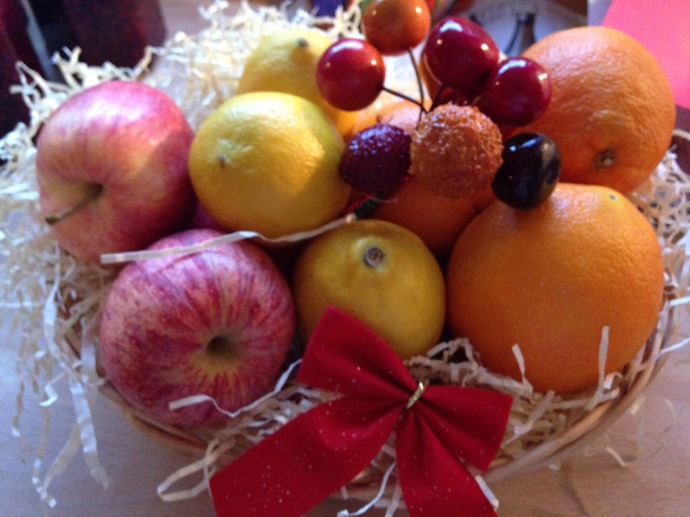 Fruit basket with some festive decorations.