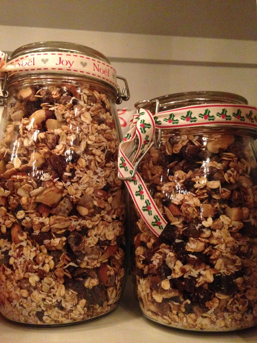 Homemade festive granola jarred, ribboned and ready for Christmas morning.