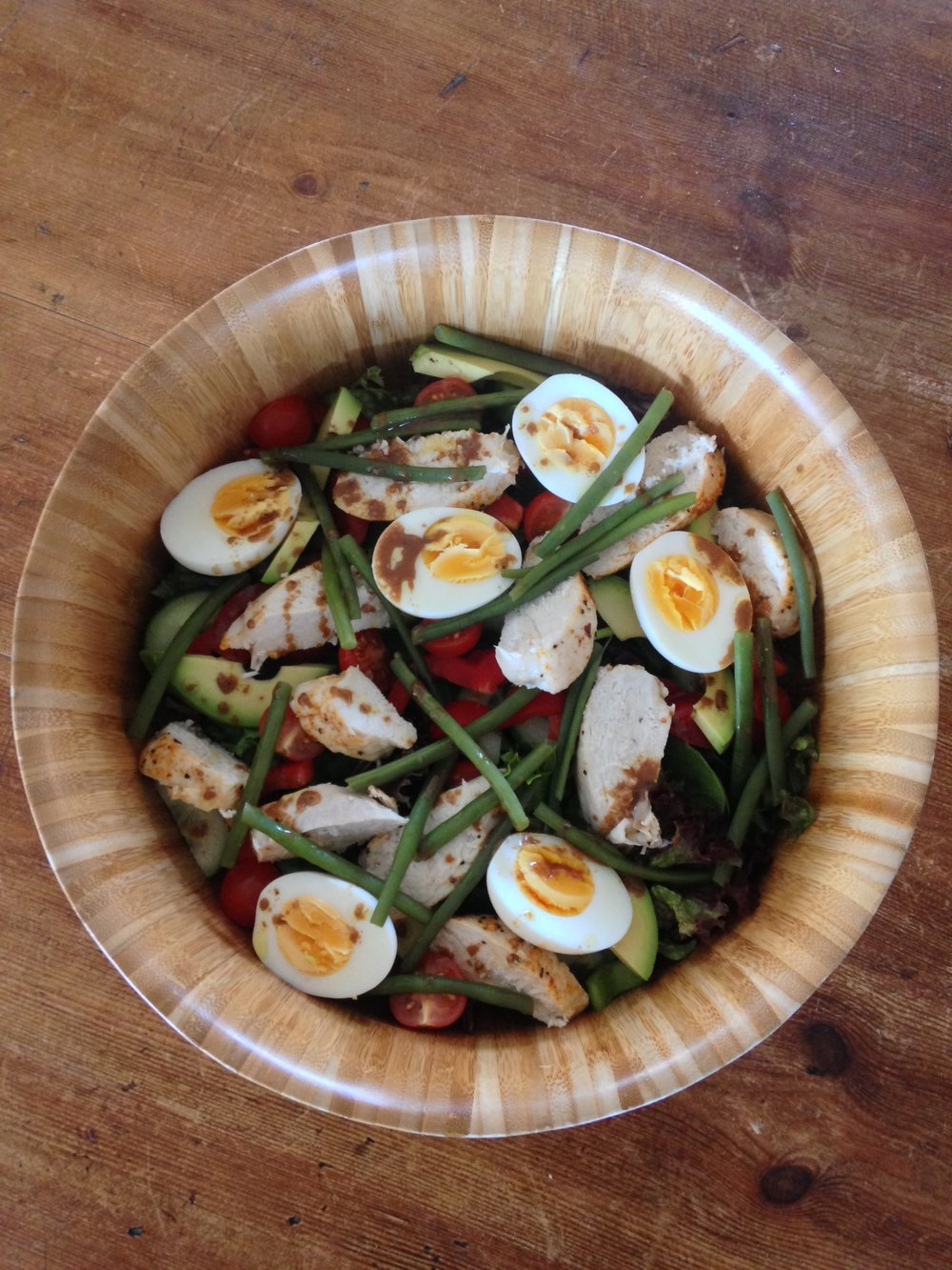 Warm roast chicken & Glenballyeamon egg salad with balsamic dressing.