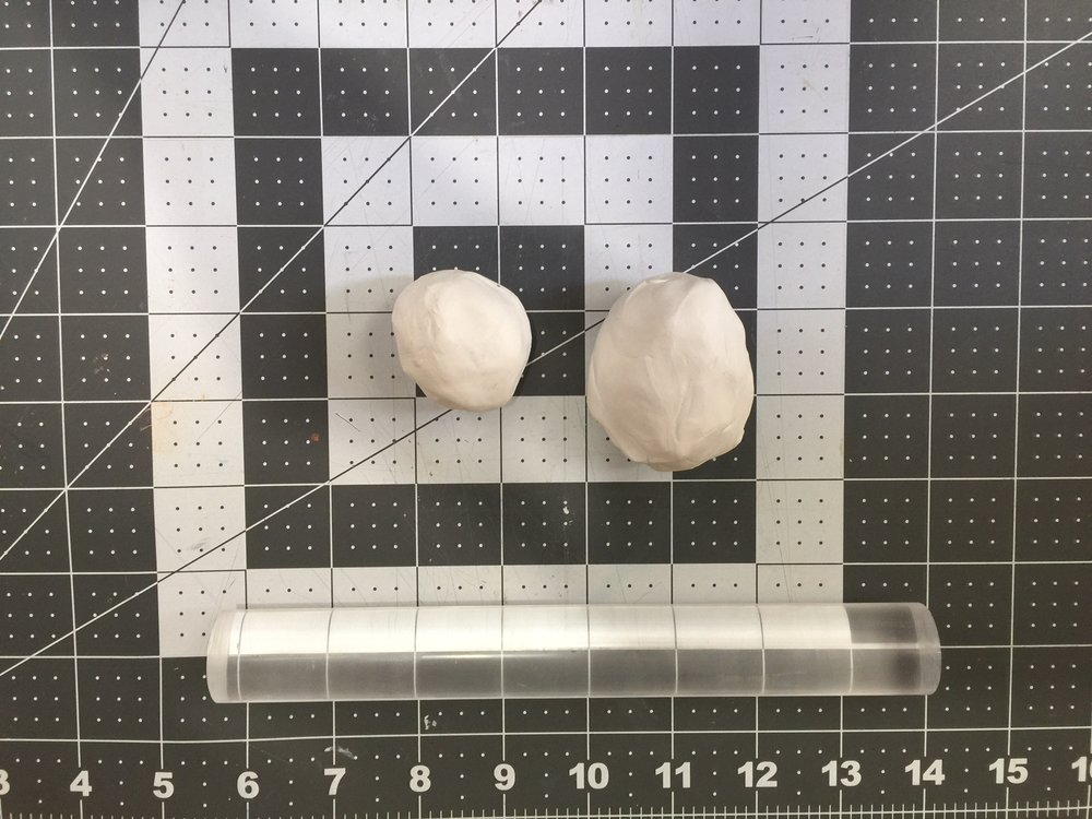 Roll your clay in a two round balls, one smaller that will be your base.