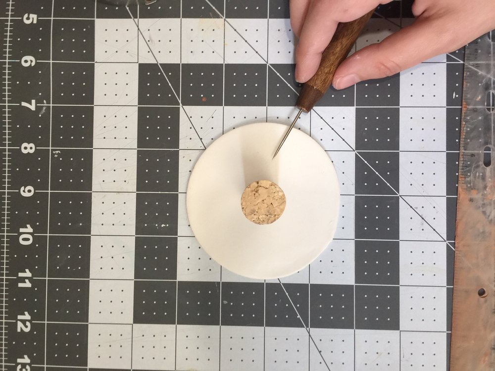 Cut around the stencil or press the cookie cutter - remove the scraps. I used a cork to trace the drainage hole in the center.