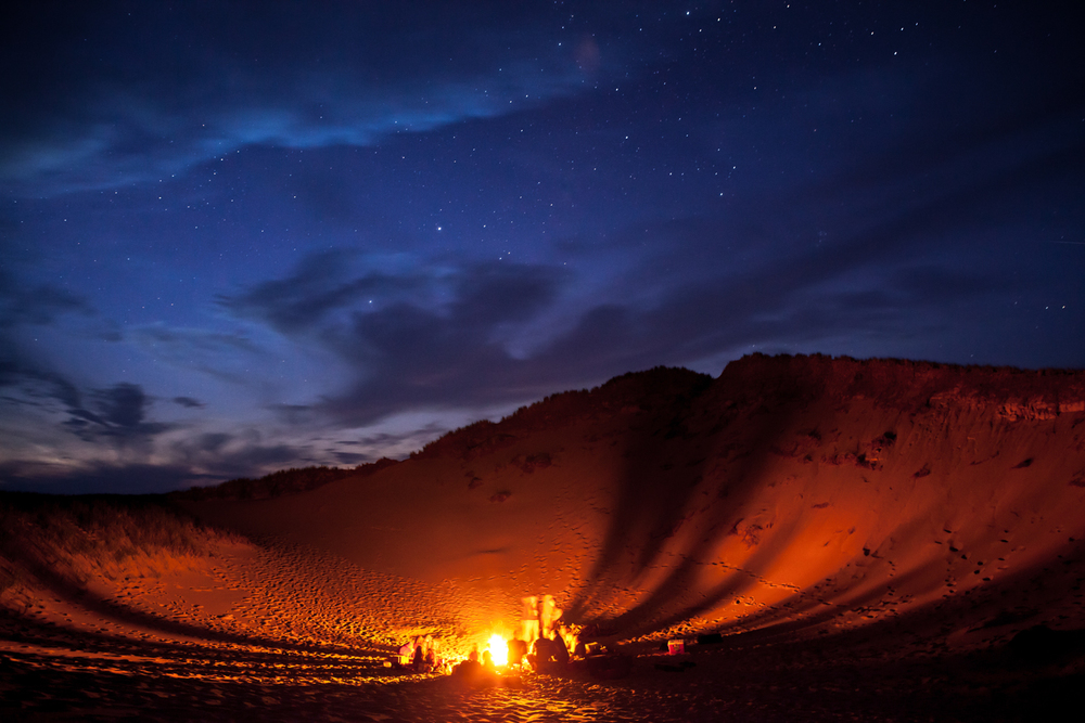 Landscape night photo in the Magdalen Islands - bonfire with friends at the Pointe-aux-Loups beach