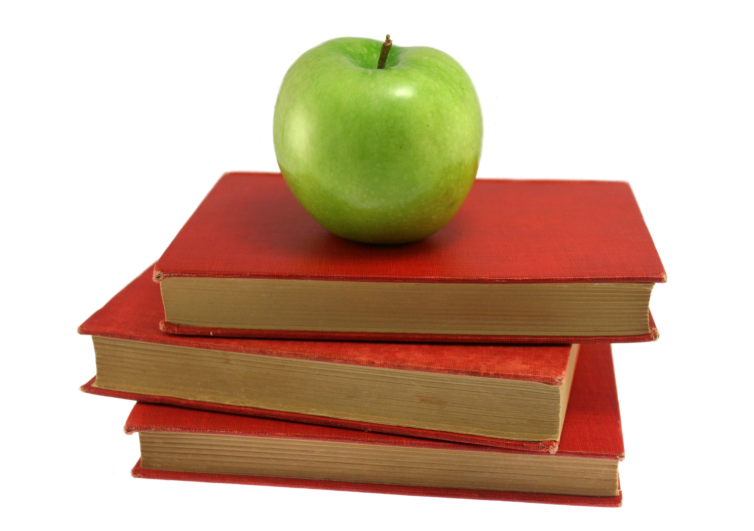 Green apple on stack of red books.