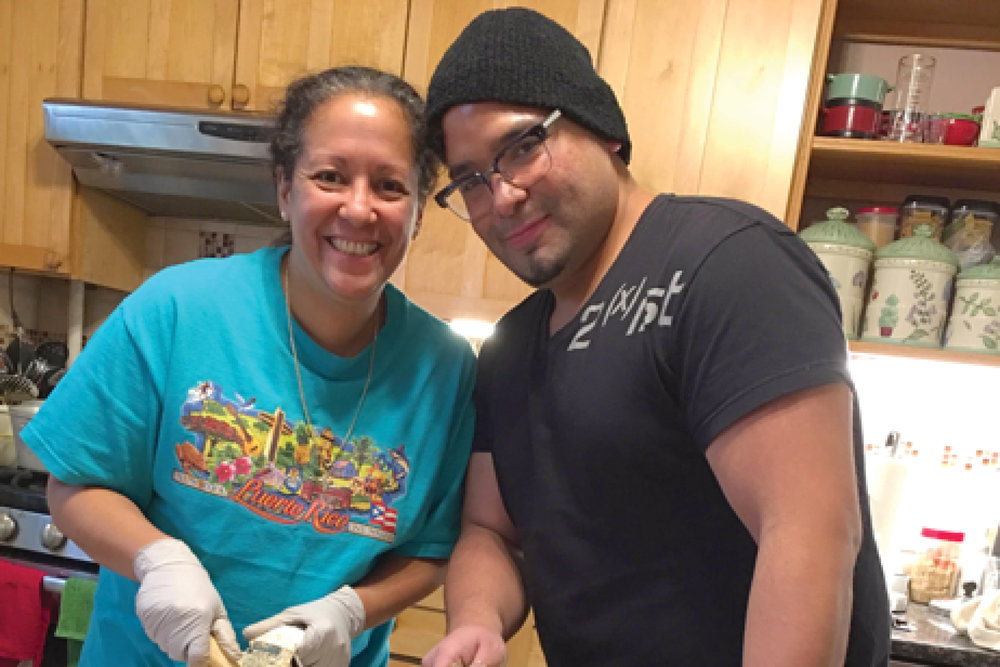 David with his sister, Rosa, making pasteles, a traditional Puerto Rican dish served during Christmas.