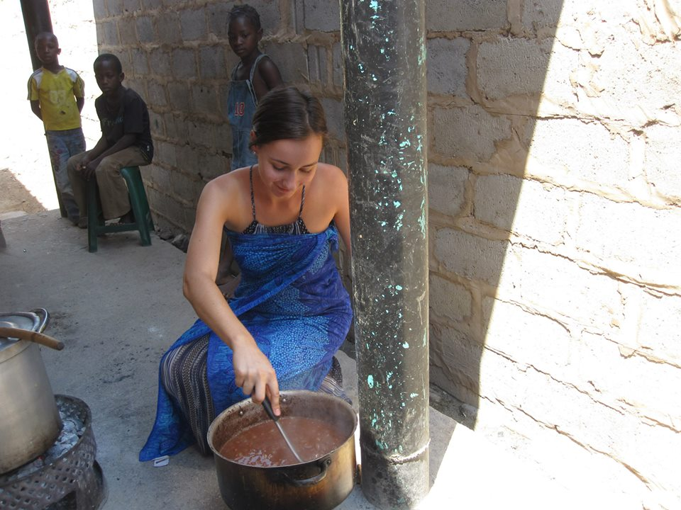 Anaëlle stirs beans that cook overnight before being served.