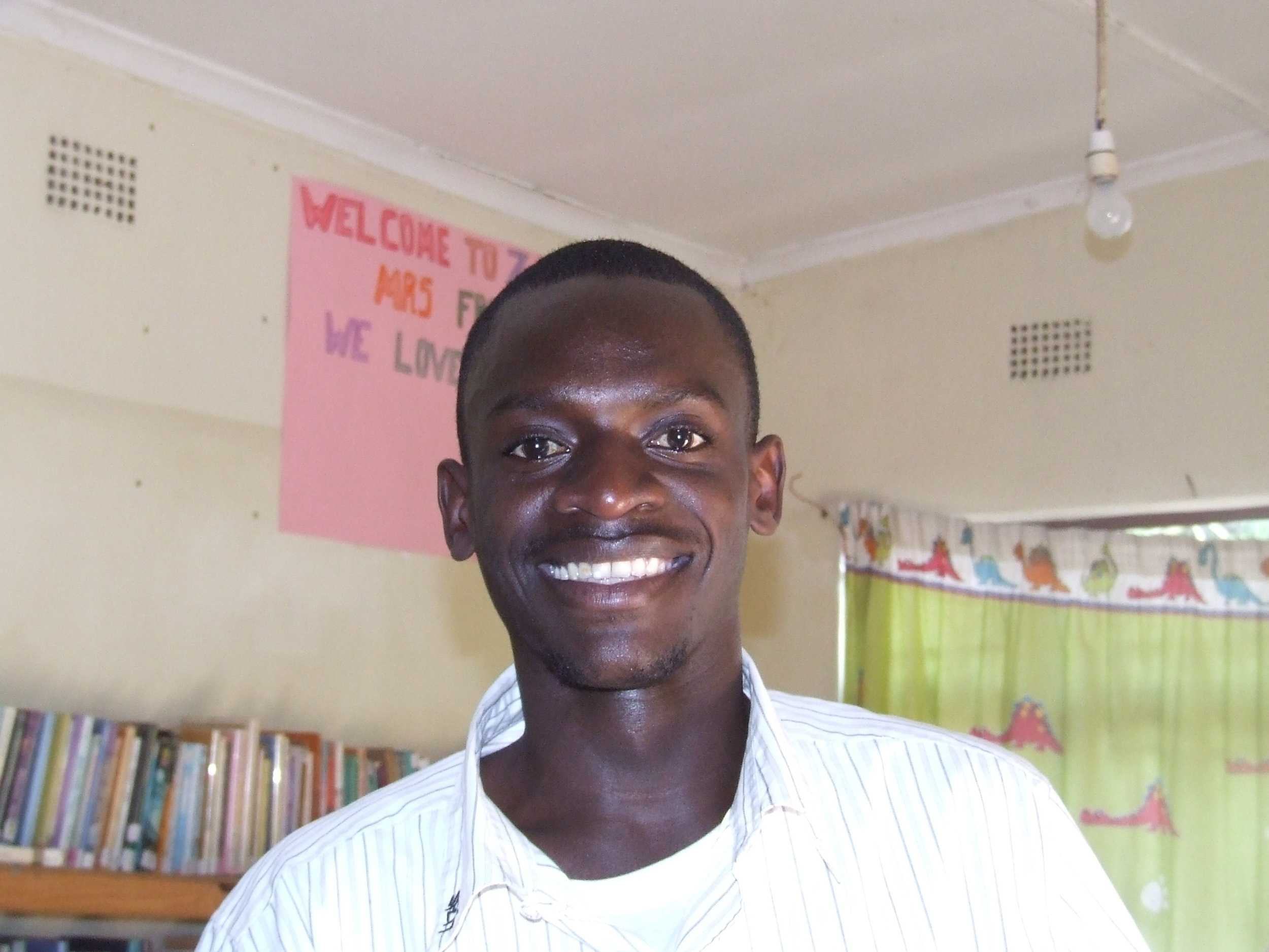 Happy in the library of the Amos Youth Centre.