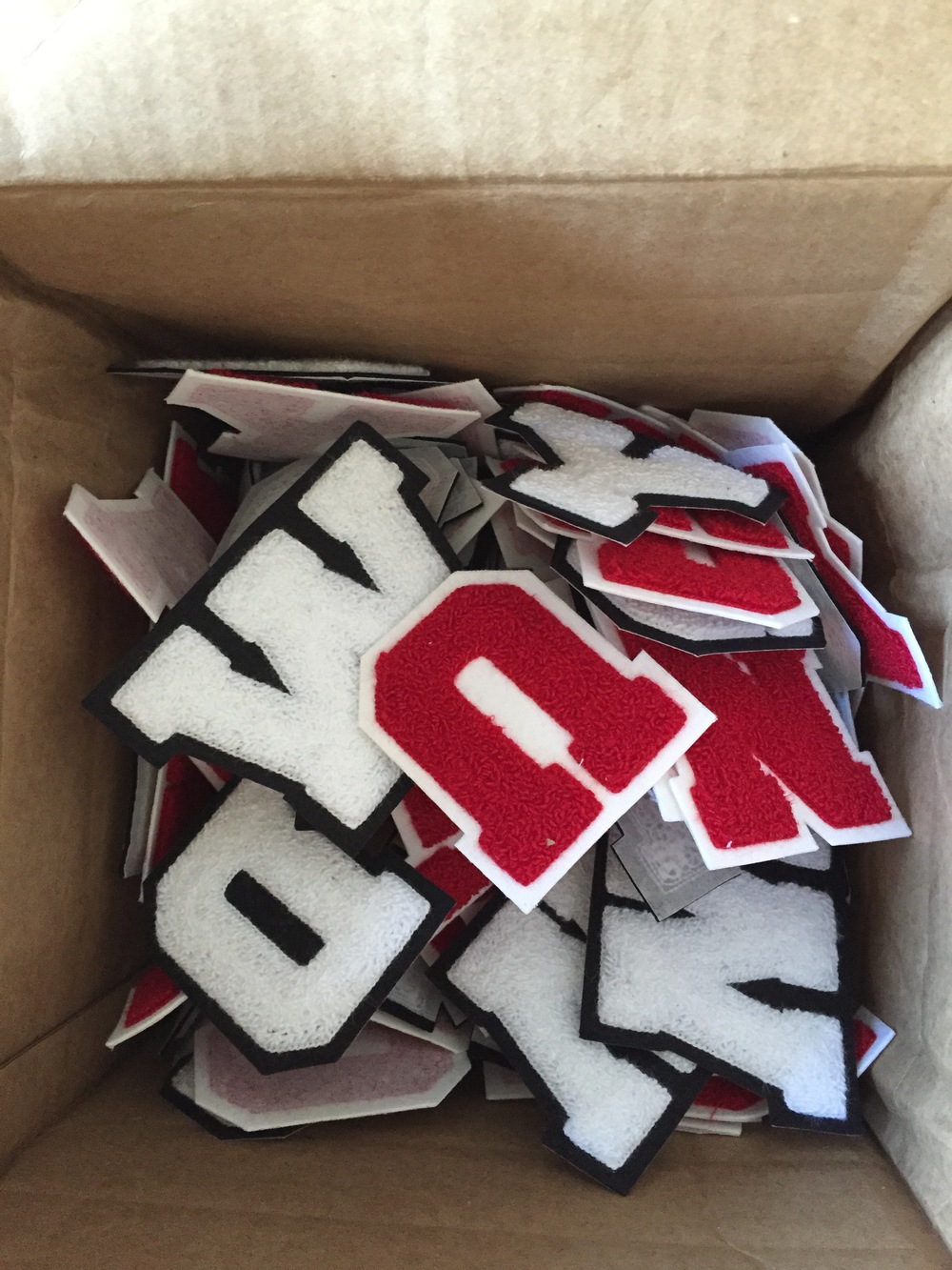 First box of Varsity Letter patches arrives from the USA. It's happening!