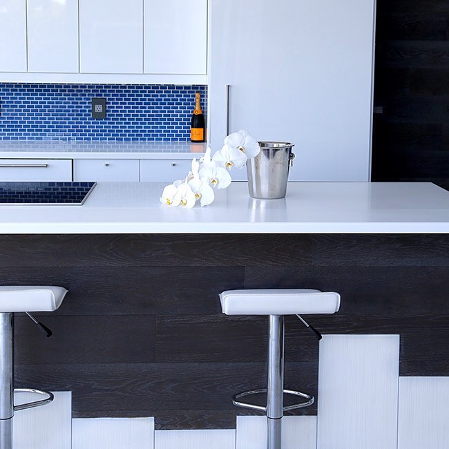 The kitchen, which was built with Ikea cabinets and Miele appliances, is the perfect mix of high-low.