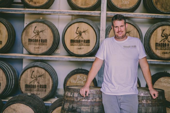 robert in front of the casks.jpg