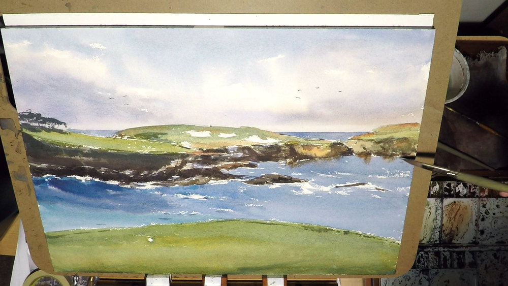 2. I did a glaze for the foreground green after it's dry. Making it a bit darker will separate it from the mid and background. This is where the viewer is standing, so it should feel solid. It's also the time to added some seagulls in the background sky and some final touches here and there.