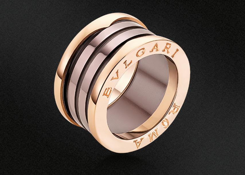 "B.Zero1""Roma"".  4-band 18 kt pink gold ring with bronze ceramic."