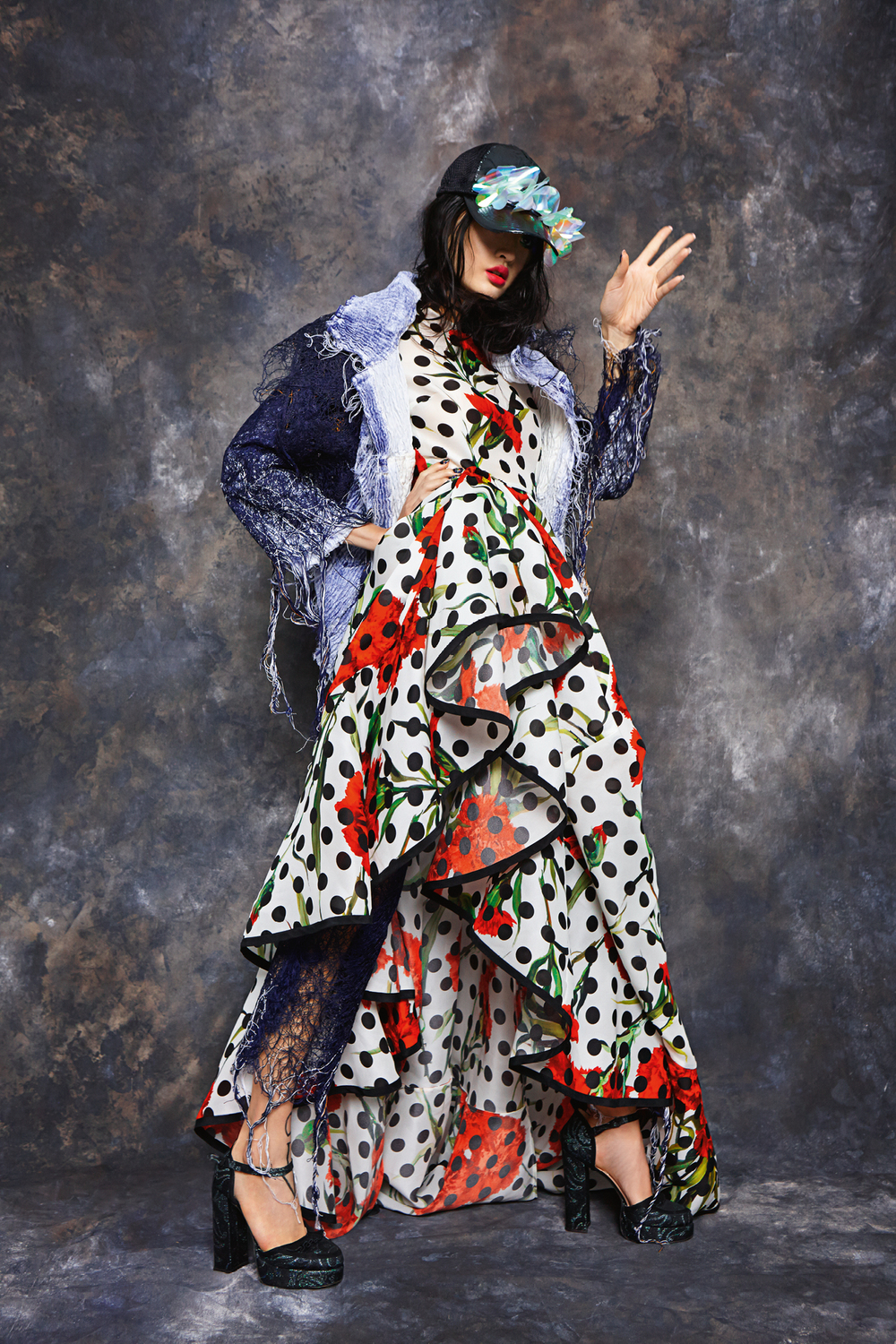 Polka dot frilled floral dress,  Dolce & Gabbana.  Jeans (worn underneath) and shredded denim effect jackets (worn over), all  Faustine Steinmetz.  Cap,  Fyodor Golan.  Head-dress,  Pebble London.  Shoes,  Micheal Van der Ham.