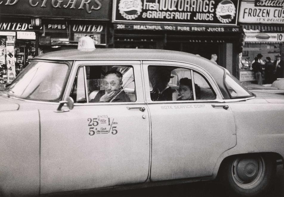 'Taxicab driver at the wheel with two passengers, N.Y.C.' (1956) © The Estate of Diane Arbus, LLC. All Rights Reserved