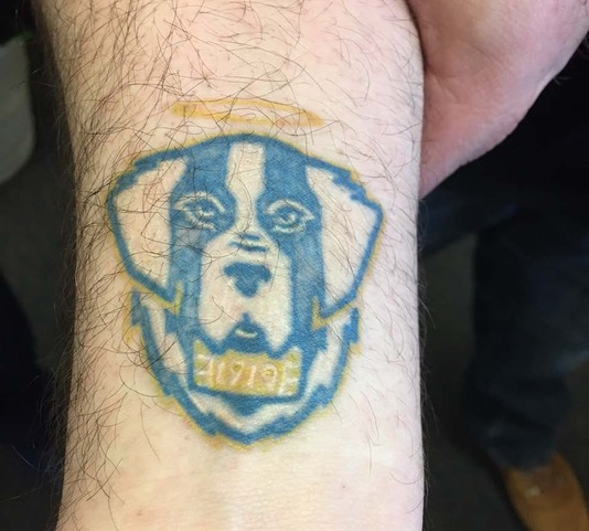One particularly committed alumnus got a tattoo of the new brand identity on his arm.