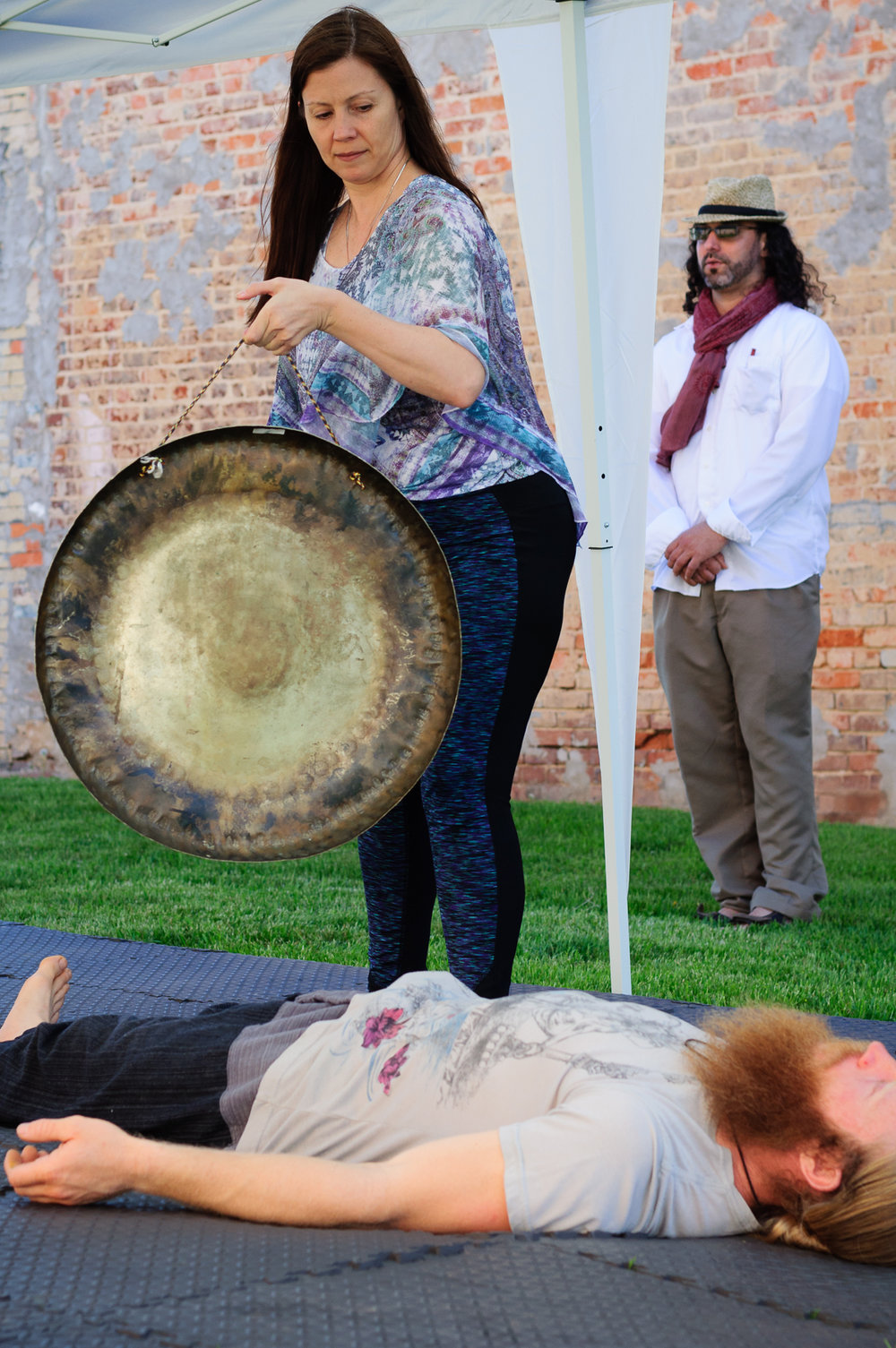 Barbara Cole and Jason Chaussee during their Self-Love Gong Meditation at the Pocket Park.