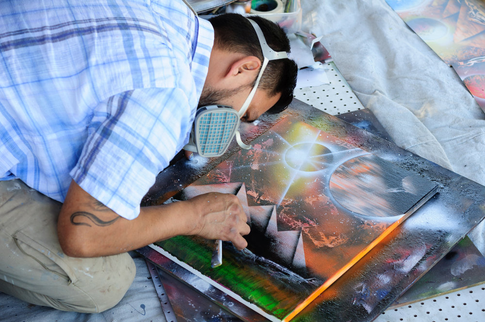 Spray Paint Artist Luis Requena applying some final touches.