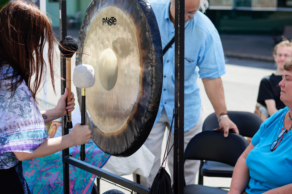 Festival goers experiencing the stress relieving benefits from gong therapy.