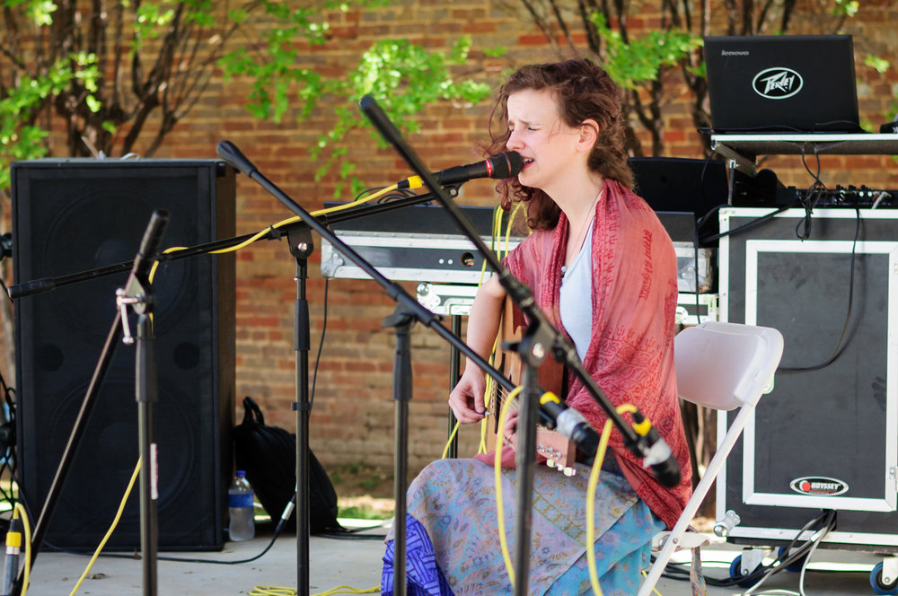On stage in Heritage Park, Daisy Windsong entertained the festival patrons with her melodies.