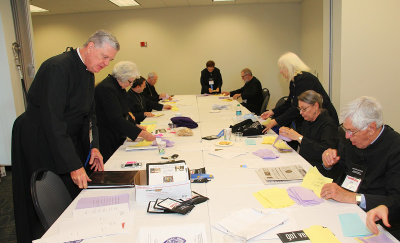 Tellers counting ballots during the Business Session of Annual Council Pictured from left to right: Karl Sachsenmaier, Linda Salmons, Paul Davison, Jim Landers, Martha-Sue Blythe, Phillip Knight, Ruth Anne Tatum, Kathryn Turman, and Jim Parks. Photo: Bill Monk