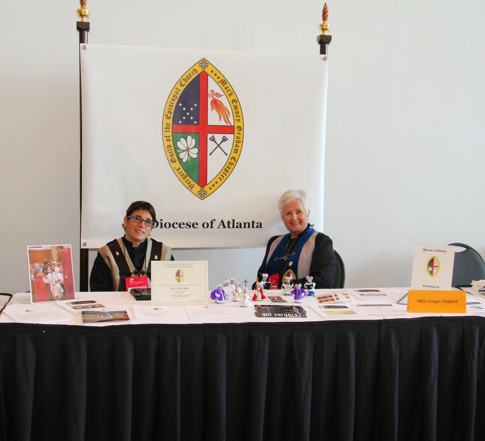 Lorie Tola and Cheryl Josephson staff the Verger Display Table.  Please notice the brand new MEG Chapter Banner. Photo: Bill Monk