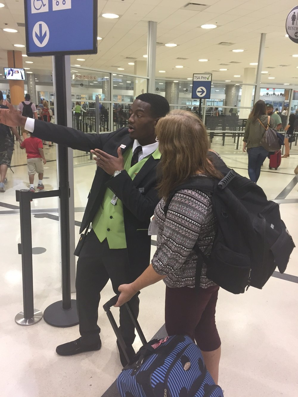 For help at the Atlanta Airport, ask an Ambassador in a green vest.