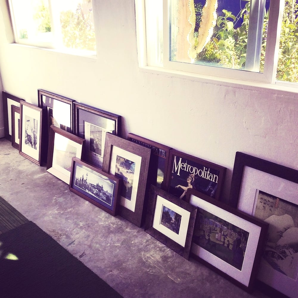 Thirteen prints and photographs, framed and ready to be hung at the apartment in West Hollywood.