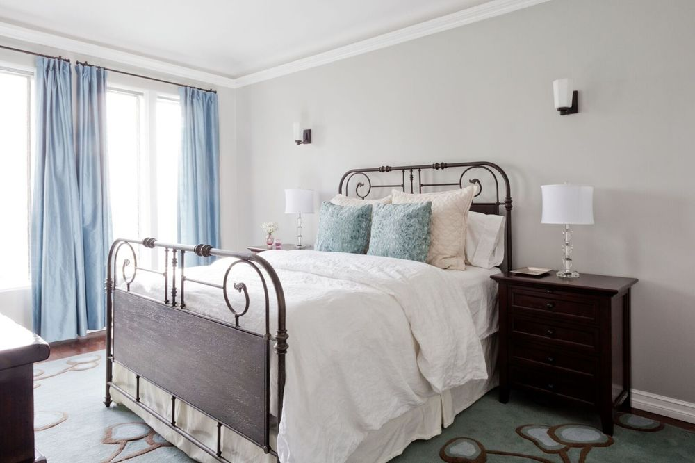 The bedroom after: the windows are dressed with robin's egg blue silk, the walls are a creamy gray and the bed is super welcoming, but my favorite thing in the room (and possibly the apartment) is the Angela Adams nasturtium rug.