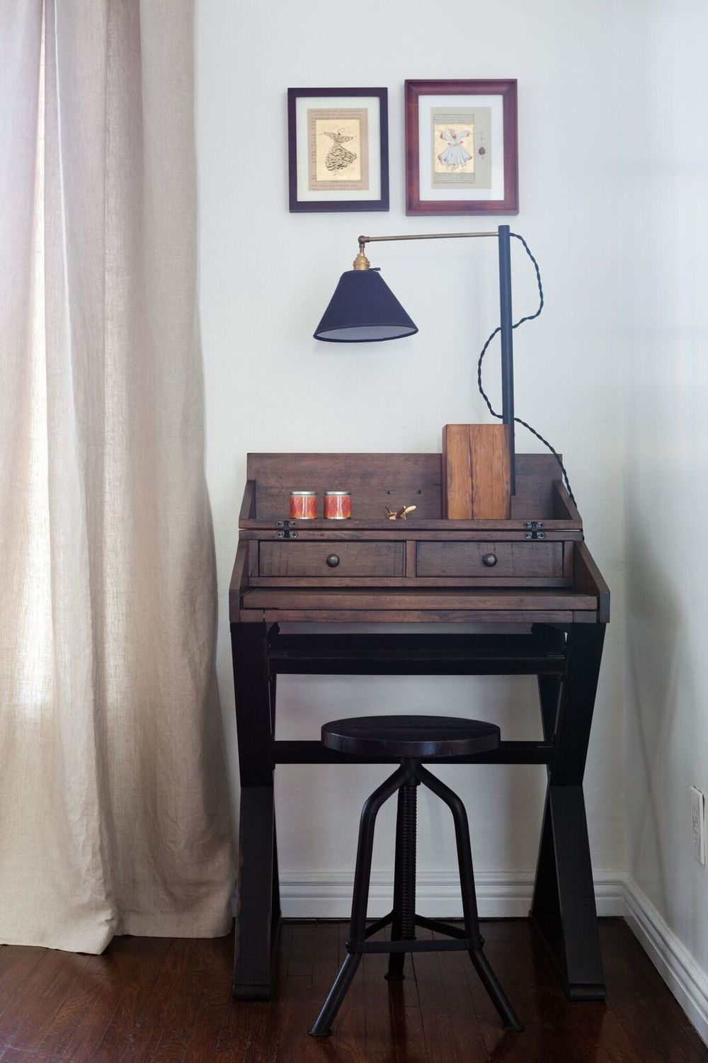 This adorable desk and (adjustable) stool are a perfect fit in this spot.  A pair of the client's vintage illustrations hang above.