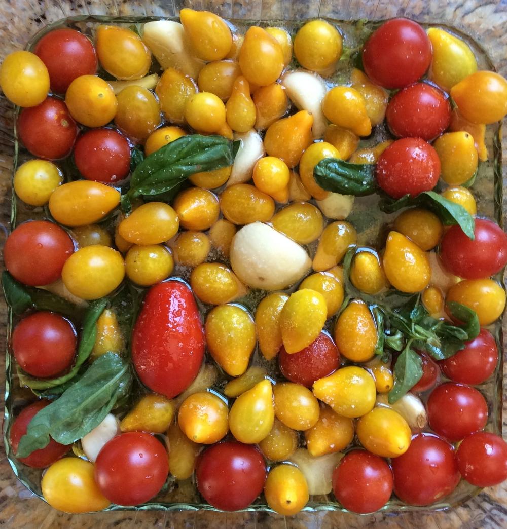 Before: Tomatoes, garlic, basil in an olive oil bath.