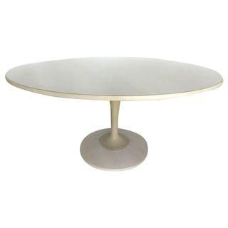 A marble top and a pedestal base. It's a classic for a reason.