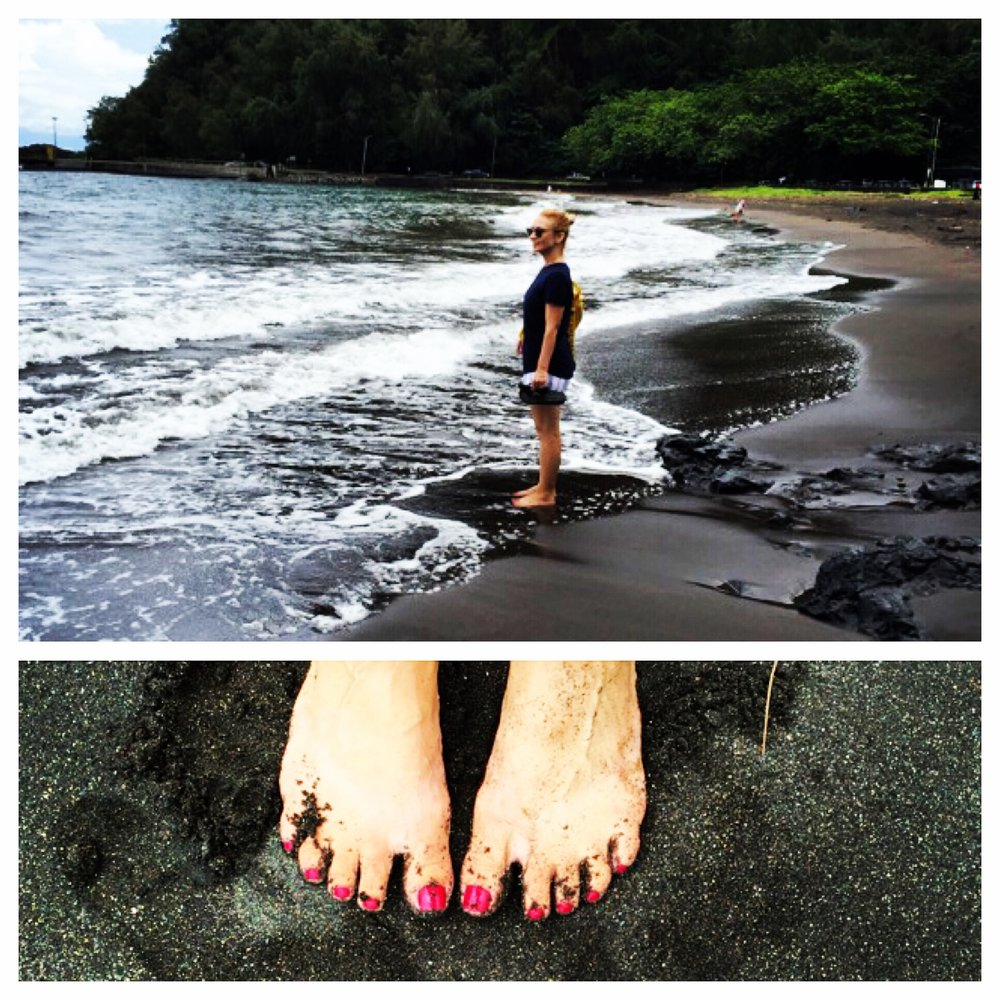 Watching the paddleboarders with my toes in the black sand at Hana Bay Beach.