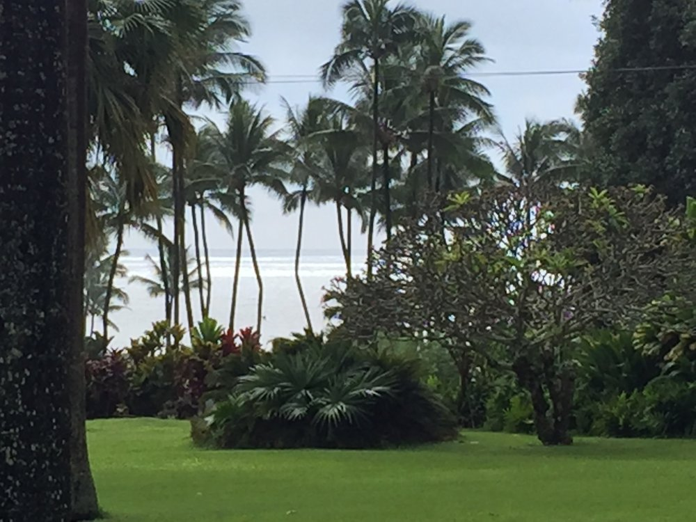 The grounds at the temple with the Pacific in the background.