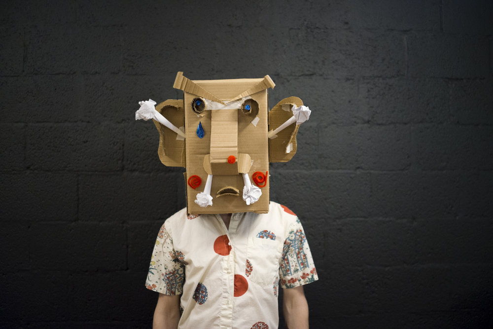 Block Head Modeling - A social event to put adult hood on hold and play. The assignment, create a wearable head piece to take part in the Block Head Modeling Club and add your head shot to our portfolio.