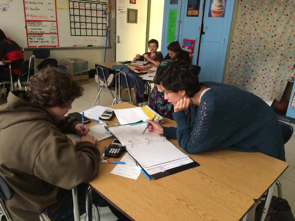 A student receives extra help on a math target he struggled with during his previous assessment.