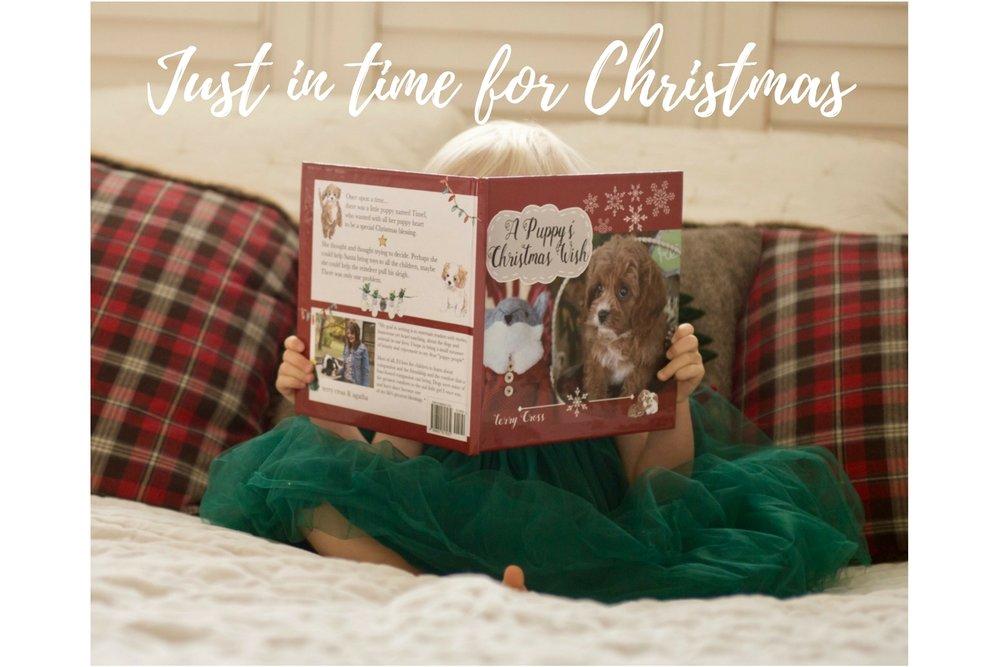 Beautiful little girl reading dog story book