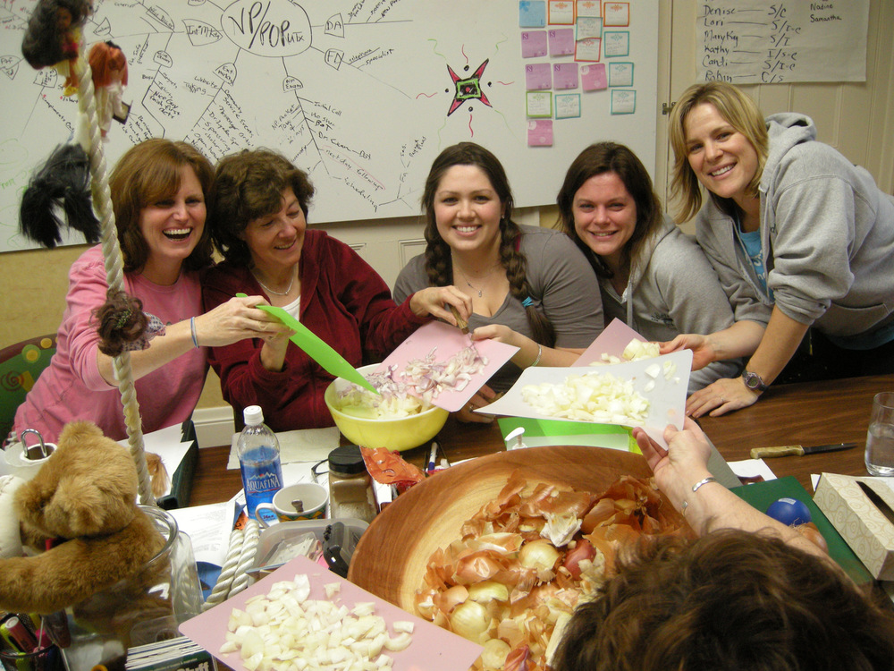 one year we pealed onions as fast as we could for an exercise in a team meeting.... all crying and laughing at the same time! Then we made soup!.. a metaphor for the way a good team works together through thick and thin.