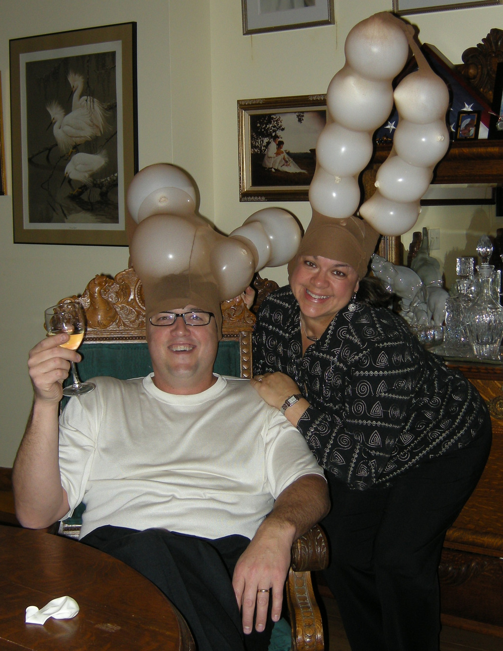 dr. lynda and dr. chuck relax after the fun and games at a holiday party.