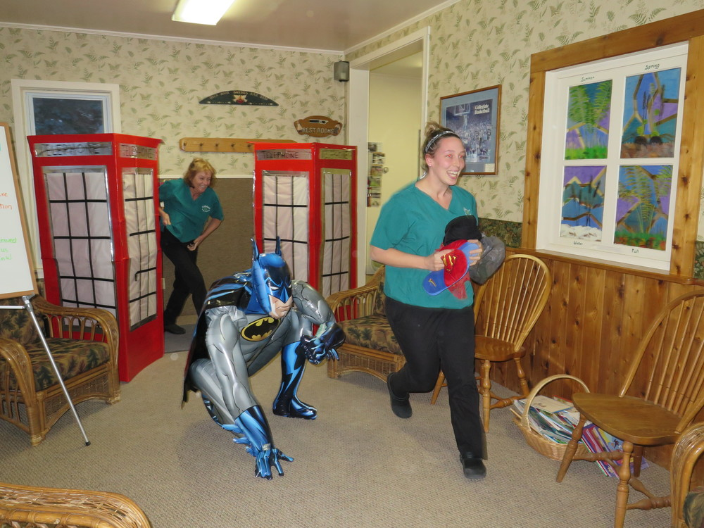 one of the games we played was a relay race to run to the end of our huge waiting room and change into our scrubs, out of our superhero costumes, in telephone booths that dr. chuck made out of REFRIGERATOR boxes!