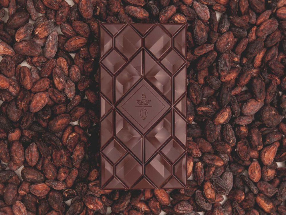 Beau Cacao chocolate bar on cacao beans