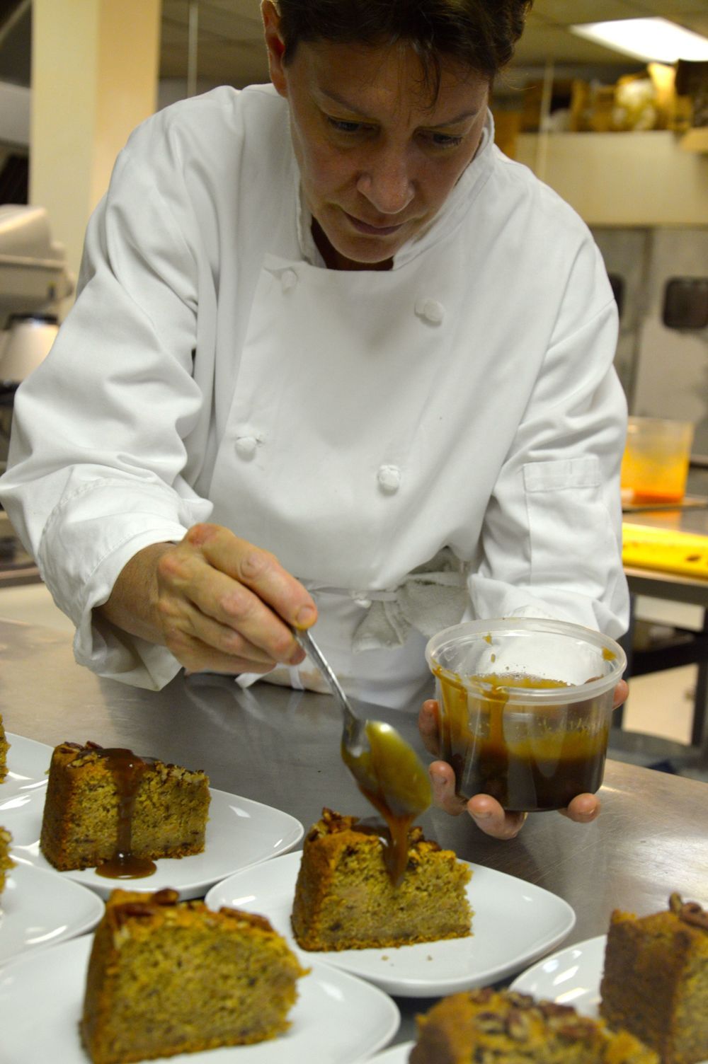 Chef Andrea drizzling caramel sauce over her delicious Quince Cake! Recipe in By The Sea :)
