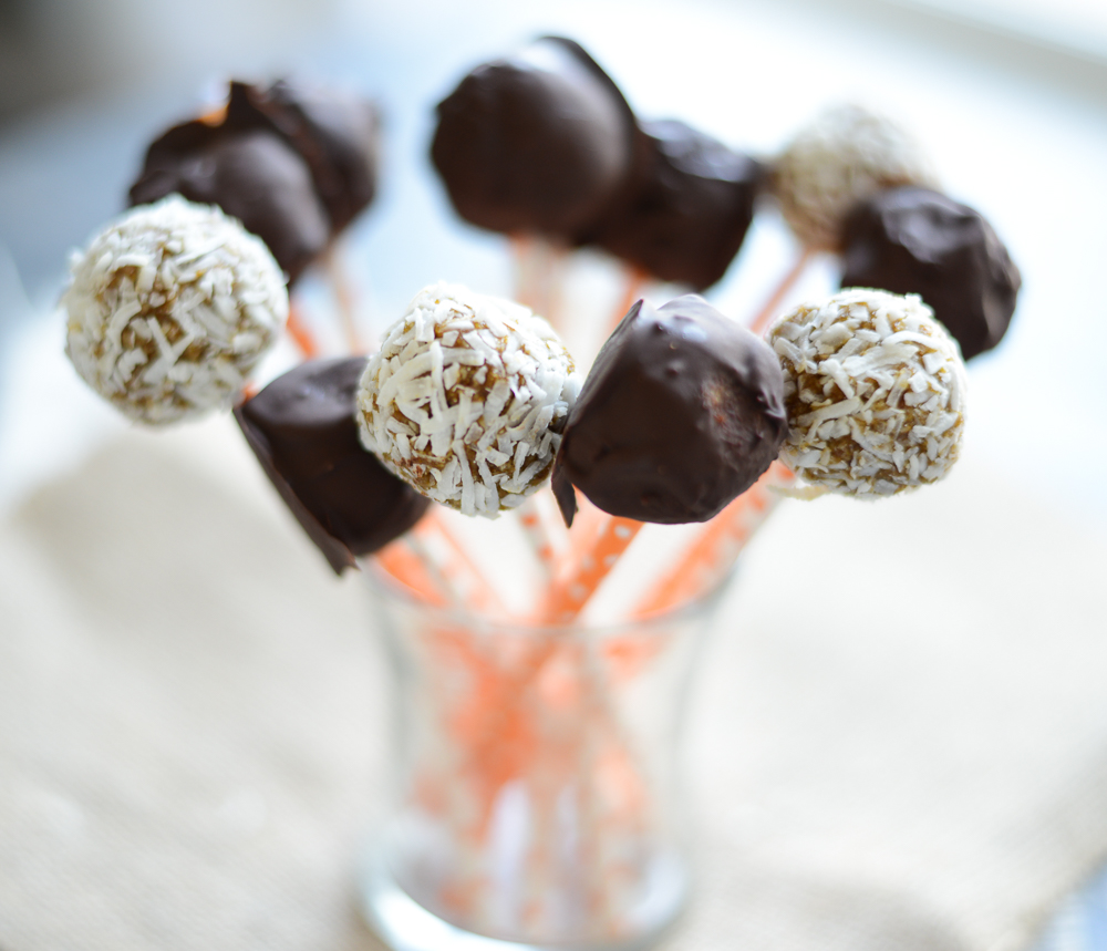 "Chocolate Covered Pumpkin Cake Pops are a decadent yet healthy treat, perfect as a sweet snack or special dessert. The ""cake"" center is really a raw energy bite, full of nourishing ingredients and super easy to make. Plus they are naturally gluten-, dairy-, and nut-free and just so darn good! #realfoodwholelife #realfoodwholeliferecipe #glutenfree #dairyfree #healthy #clean-eating #fall #fallrecipe #pumpkin #pumpkinrecipe #halloween #halloweenparty #healthyhalloween #thanskgiving #healthythanksgiving #pumpkinspice"