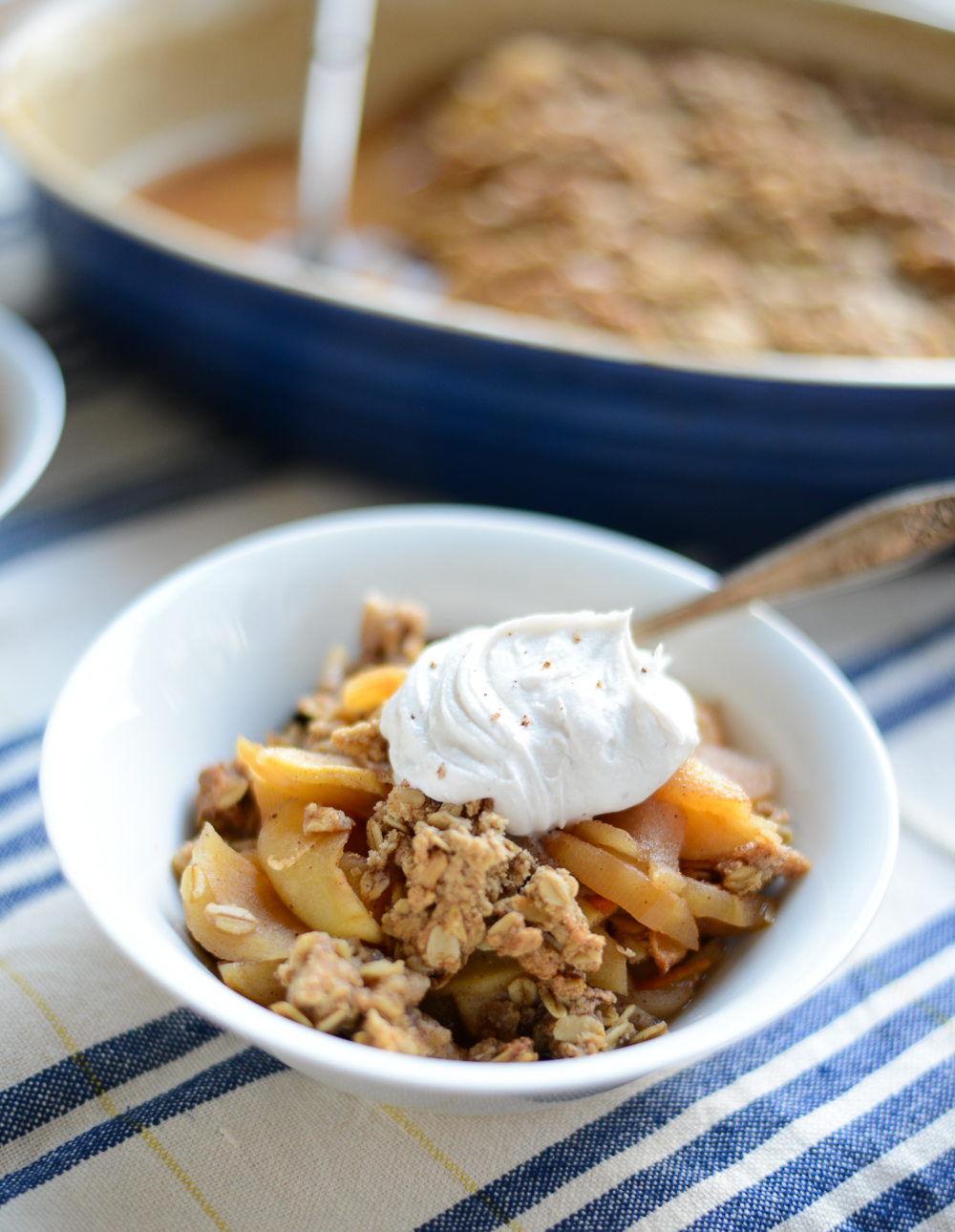 The perfect dessert to serve a crowd, Healthier Old-Fashioned Apple Crisp is brimming with lightly sweet cinnamon-spiked apples and topped with a crunchy, satisfying oat topping. It's also naturally gluten- and dairy-free, so you can enjoy this comforting dessert more often! #healthy #realfood #recipe #fall #dessert #applecrisp #glutenfree #dairyfree #nutfree #refinedsugarfree #vegan #vegetarian